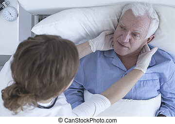 Doctor examing patient in hospital - Doctor examing hospice...