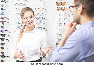 Well find perfect eyeglasses for you - Young optometrist...