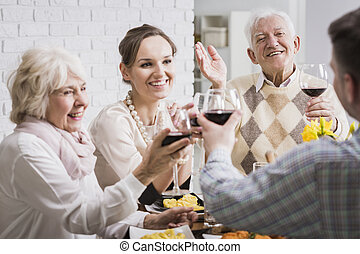 Family making a toast at dinner - Happy family making a...