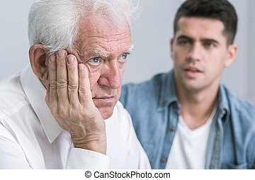 How can i help you dad - Sad senior man and his young caring...