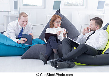 Business meeting in a modern way - Group of businesspeople...