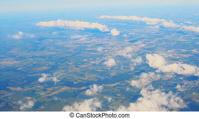 Flying through white Clouds at daytime