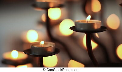 Candle flame at night in church Abstract glowing background...