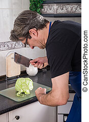 Clueless cook - Guy trying to chop lettuce with a meat...