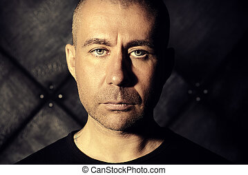 introspective - Close-up portrait of a man in black clothes...