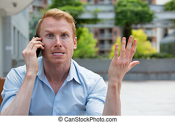 Nightmare phone calls - Closeup portrait, young man annoyed,...
