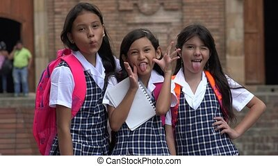 School Girls Making Funny Faces