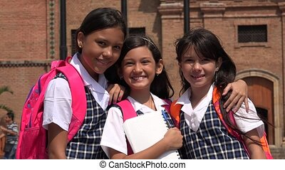 Smiling School Girls Showing Peace Symbol