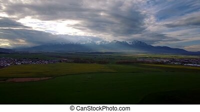 4K Aerial, Plain Field With View On High Tatra Mountain...