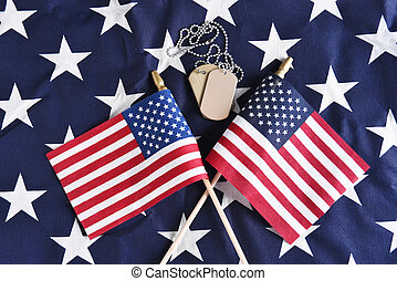 Dog Tags and Crossed Flags - Top view of two crossed...