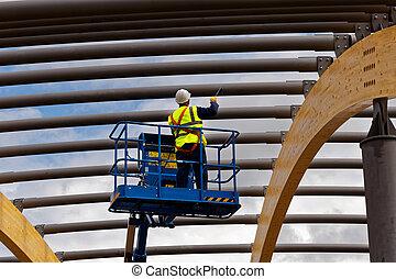 man painting steelwork