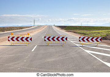 Road Barriers on a New Road - Three road signs barriers...