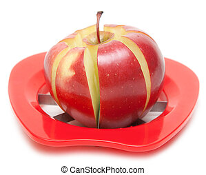 Red apple and special knife for cutting on segments