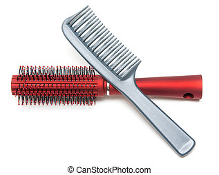 Two combs, red and sulfuric insulated on white background
