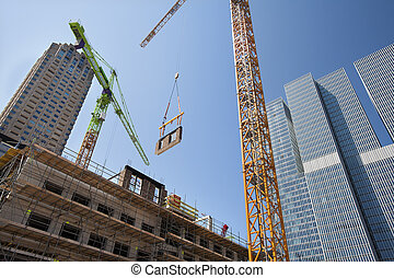Crane lifting a wall on a construction site in Rotterdam...