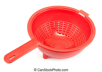 Red brilliant plastic colander insulated on white background