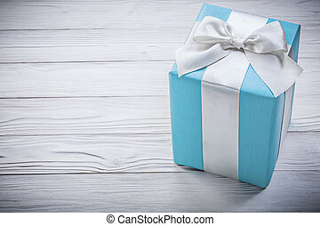 Blue gift box on wooden board celebrations concept.