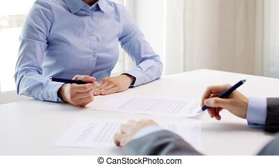 business partners signing contract and shake hands -...