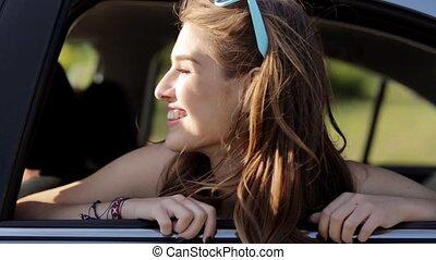 happy teenage girls or women in car at seaside 63 - summer...