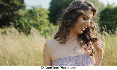 Caucasian lady stand in the field and smile - Young woman...