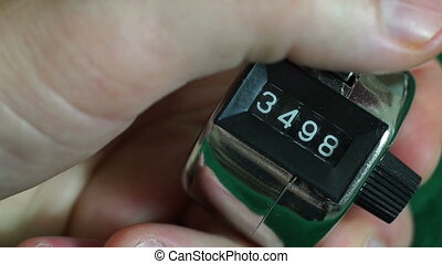Hand Tally Counter Macro - Close up macro shot of a...
