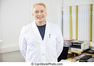 Confident Mature Doctor Smiling In Clinic