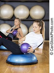 Women Exercising With Medicine Ball - Young women exercising...