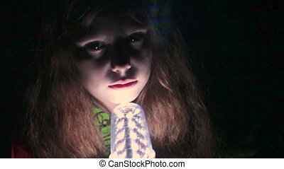 Girl tells scary stories around the - Girl teenager tells...