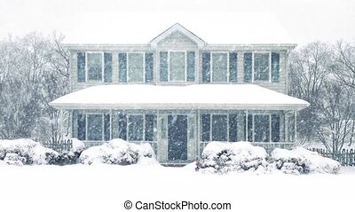House In Winter Snowstorm - House covered in snow in heavy...