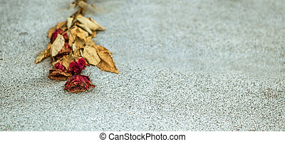 faded rose - on a stone slab is a faded rose. symbol photo...