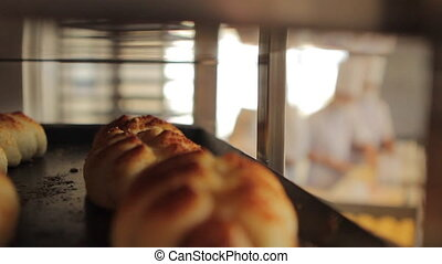 Crusty buns on shelving - Freshly baked buns on shelting...