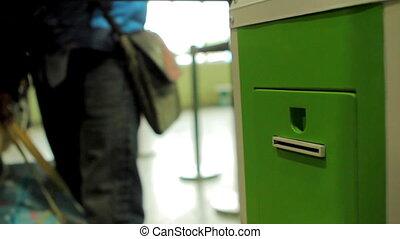 Terminal to have voucher queue - Boy taking voucher in...