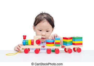 girl playing with wooden train toy - Little asian girl...