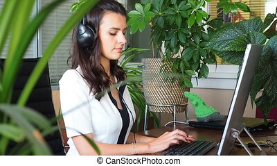 Woman talking on headset in office - Steadycam shop of...