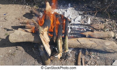 stacked crosswise fire burning - firewood, stacked crosswise...