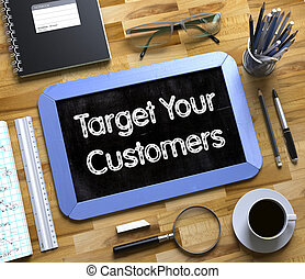 Target Your Customers - Text on Small Chalkboard.