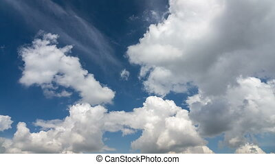 Clouds running across the blue sky.