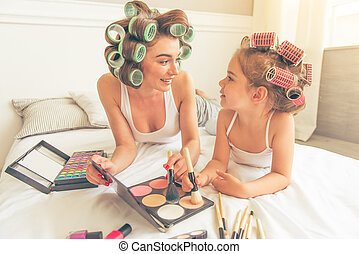 Mom and daughter at home - Beautiful young mother and her...