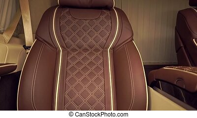 Luxury brown leather car seat tilt close up shot - Luxury...