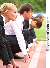 Leading runner - Image of businesswoman looking attentively...