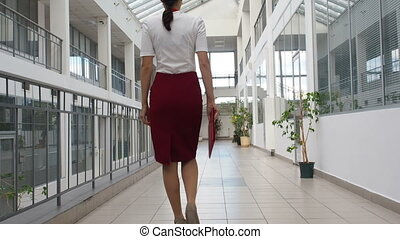 Business woman walks in office