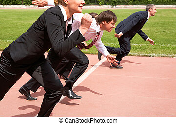 Running people - Image of active employees running on sport...