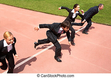 Competition - Photo of business people running on sport...
