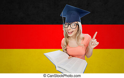 student woman in mortarboard with encyclopedia - people,...