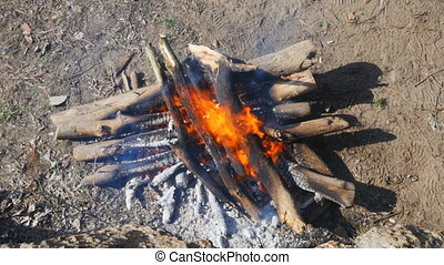 burning wood fire from above - firewood, stacked crosswise...