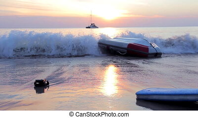Inflatable upturned boat near the beach - Sea wave beating...