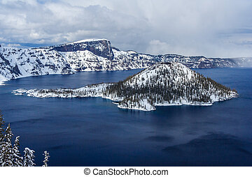 Wizard Island in caldera lake in Crater Lake National Park,...