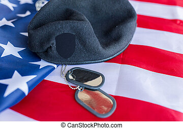 close up of american flag, hat and military badge - military...