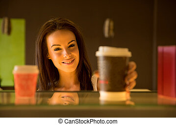 Young woman taking away a coffee - Portrait of a beautiful...