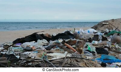 Pollution on the beach of tropical island. Contamination of...